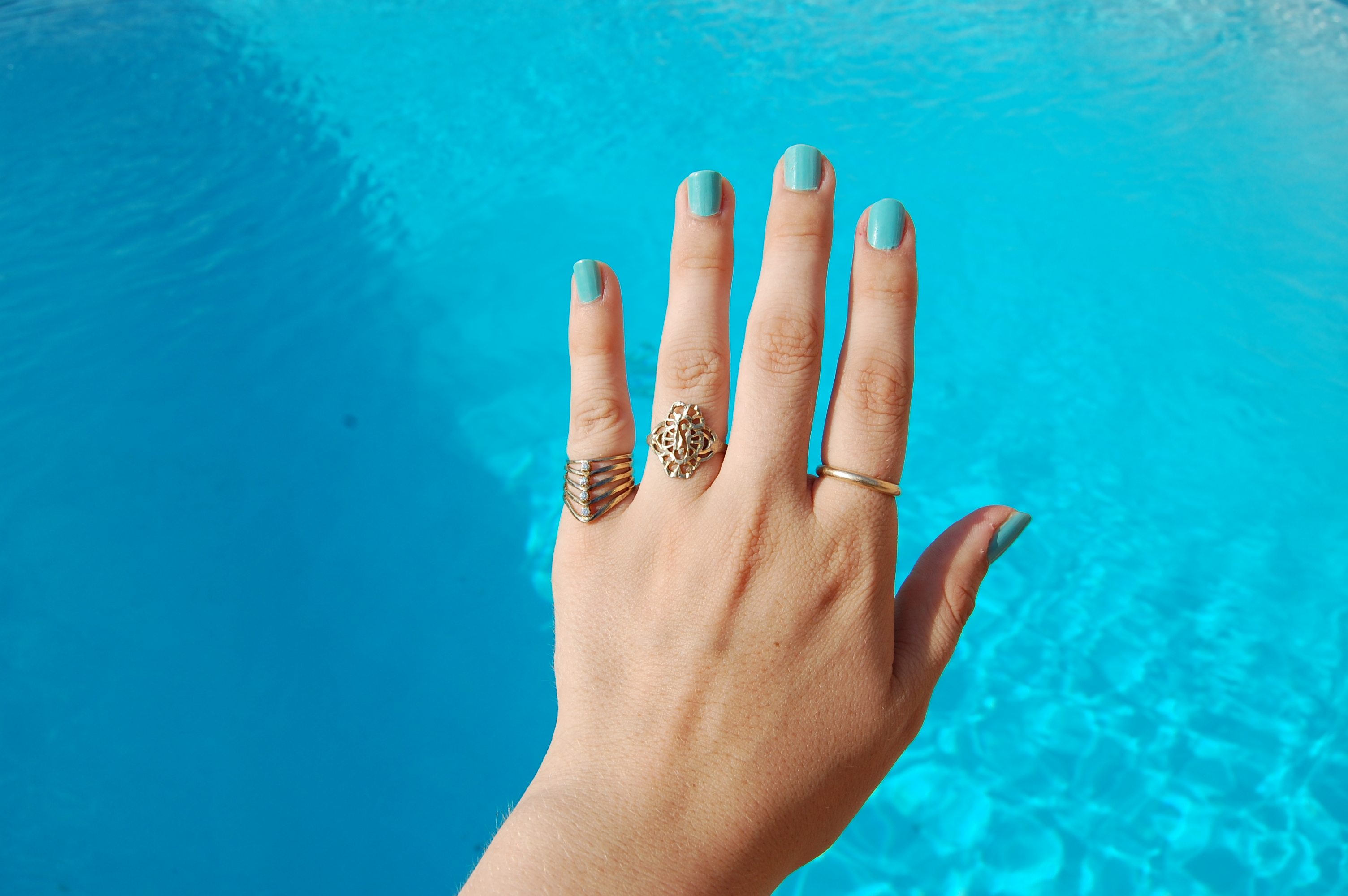 of woman your find rings thumb turn ring finger image out holding why cropped green